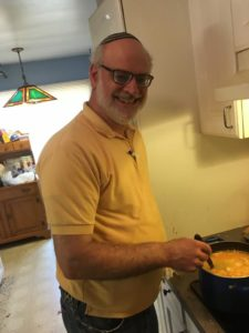David Barth cooks up a batch of cheese.